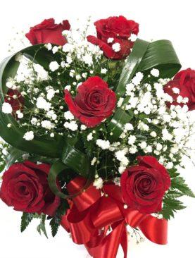 Composizione in vaso rose rosse e nebbiolina